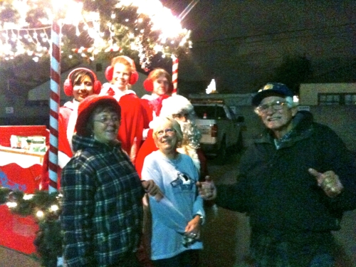 Santa and his Lawndale Rotary club Helpers, Hedy Downing, Bev. Terensinski, and Bob Downing