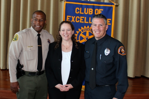 Deputy Troy Hilliard, Lawndale Rotary President Deborah Holland and Firefighter Robert Courrier.